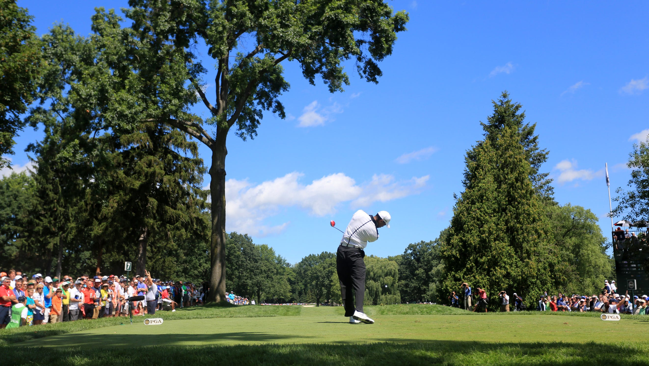 Aug 10, 2013; Rochester, NY, USA; Tiger Woods tees off on the 7th hole during the third round of the 95th PGA Championship at Oak Hill Country Club.. Mandatory Credit: Allan Henry-USA TODAY Sports ORG XMIT: USATSI-120258 ORIG FILE ID:  20130810_pjc_ah2_028.JPG
