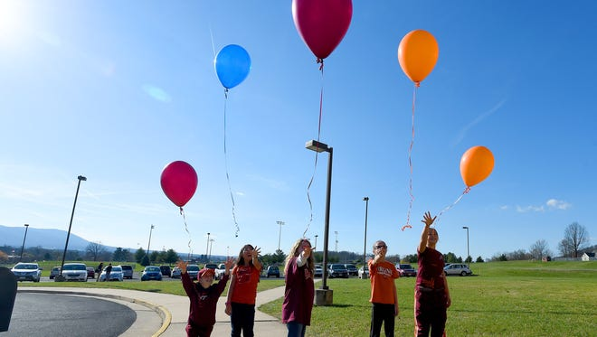 Fifth-graders Isaiah Blevins, Kaili Wheeler, Emily Sackett, Laura Gillespie and Amelia Bartley release balloons as they honor the memories of Norah Mastrandea and Ethan Blevins, both lost to childhood cancer, outside Stuarts Draft Elementary on Tuesday, Nov. 24, 2015. The school held a fund raiser to raise money for the MaDee Project which provides support to pediatric cancer patients and their families.