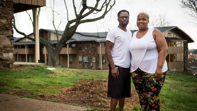 Nakiesha Hunter and her husband, Zepf Okonkwo, stand outside their apartment in the Prestige Pointe complex in Nashville. They share a three-bedroom Section 8 apartment at Prestige Point with their three children that costs under $6 a month because Hunter is unemployed.