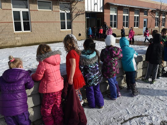 Children line up to return to the classroom from recess at Rice Elementary in Wellington on Thursday, January 12, 2016.