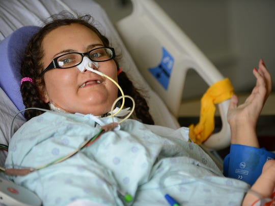 Brittany Van Hoogen sits in her hospital room on Thursday,