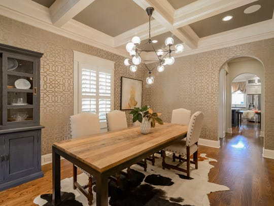 Arched doorways lead to the elegant dining room.