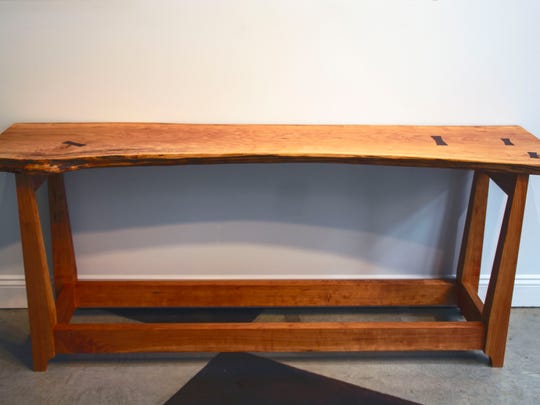 """A table made by Indiana woodworker Peter Falk, featured in the """"Story Telling in Wood"""" exhibit at ArtSplash Gallery in Carmel."""