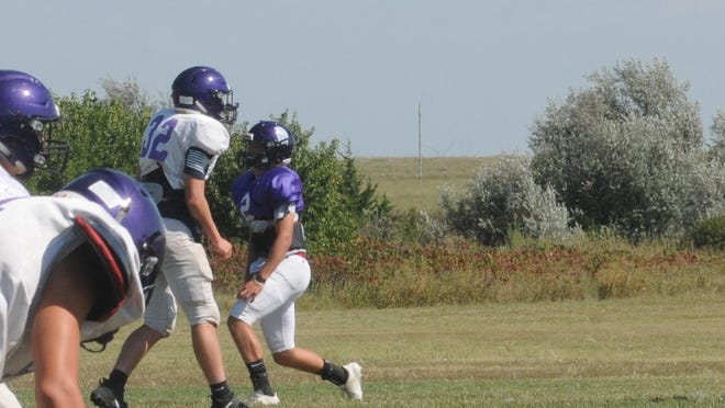 Southeast of Saline head coach Mitch Gebhardt, right, watches his players during a practice drill Wednesday.