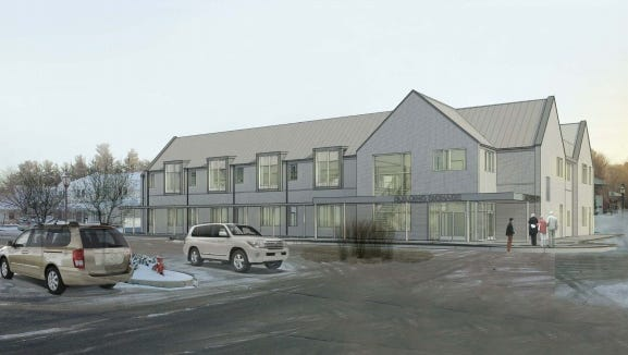A new rendering of the Cayuga Medical Associates proposal for the Community Corners shopping plaza in Cayuga Heights. The previous building was one story taller and included a dermatology practice.