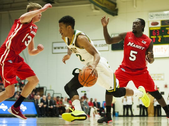 Catamounts guard Trae Bell-Haynes (2) drives to the