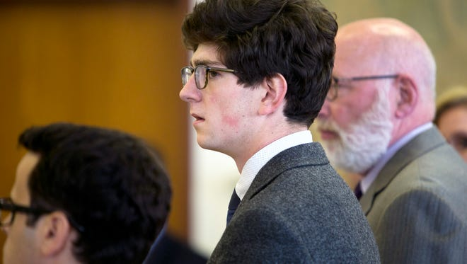 Owen Labrie looks over at jury as his verdict is read at Merrimack County Superior Court on Friday, Aug. 28, 2015 in Concord, N.H.