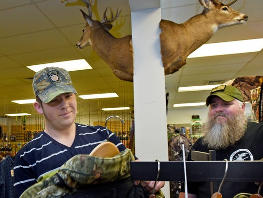 Sean Schock, 15, left, Waynesboro, looks for new hunting
