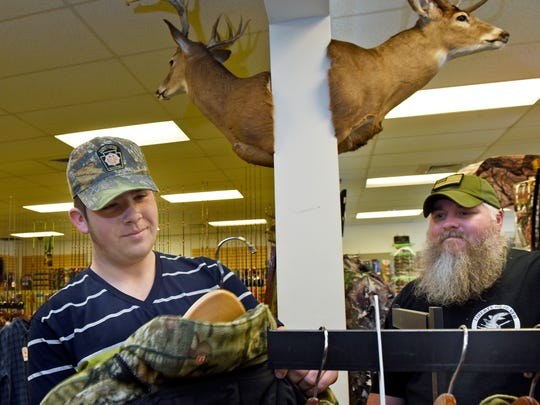 Sean Schock, 15, left, Waynesboro, looks for new hunting apparel with help from employee Steve Reever at Sportsman Deals, 1607 Orchard Drive, Chambersburg, Tuesday, November 11, 2016. Rifle deer hunting season starts on Monday.