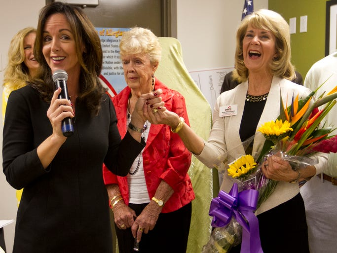 Lizbeth Benacquisto, left, congratulates Gail Markham after the Lee County Pace Center for Girls was dedicated in Markham's honor on Tuesday at the Pace Center's new building in Fort Myers. Over the course of the seven year campaign, PACE has raised more $1,315,000.00 to purchase the new school. Lee Memorial Health Systems donated the land and big donations like Cheryl & Dave Cophamâ??s $100,000 matching gift has helped PACE almost complete the fundraising campaign.