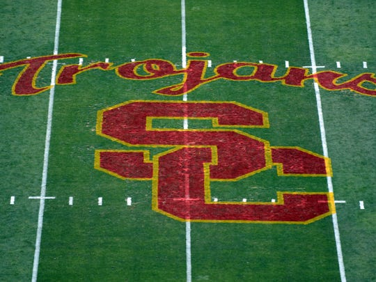 A view of the USC Trojans logo at midfield at the Los Angeles Memorial Coliseum.