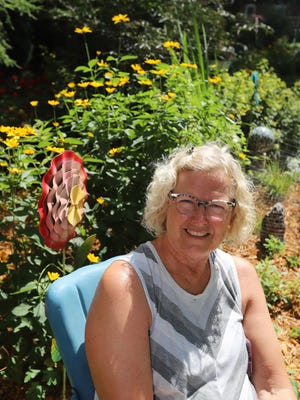 Penny Sudbeck in her garden Wednesday July 8, 2020 at 2616 West Ave. in Burlington. Her home is one of seven on the The Heritage Trust of Burlington Garden Tour on Saturday.