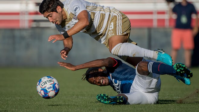 Louisville City FC midfielder Oscar Jimenez (19) collides with New England Revolution forward Femi Hollinger-Janzen (88) during the game played at Lynn Stadium in Louisville, Ky, June 5, 2018.