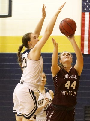Odessa-Montour's Gillian Clark puts up a shot as Notre Dame's Mary Foster defends Thursday night at Notre Dame High School.