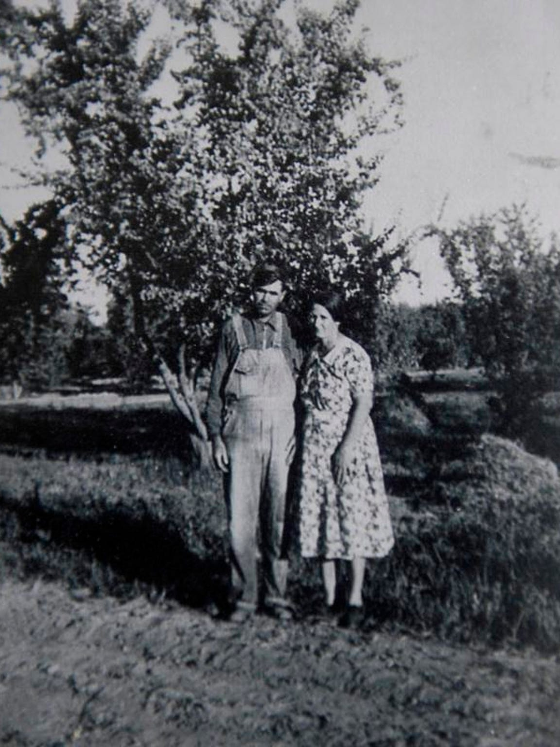 "Pictured are Eunice Kincade's parents, Roy and Samantha ""Mattie"" McCollum, standing in front of a peach tree at Tagus Ranch. Kincade, 87, who grew up on the ranch, said she's been to a few of the Tagus Ranch reunions but did not go to the last one. ""All the people I knew are gone now, just about,"" she said."