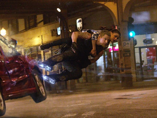 Channing Tatum as Caine Wise, rescues Mila Kunis as Jupiter Jones from danger in Jupiter Ascending, an original science fiction epic adventure from Lana and Andy Wachowski.
