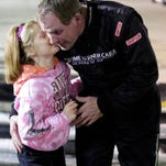 Jeff Van Oudenhoven talks with his daughter, Mayson after winning a race at Wisconsin International Raceway in Buchanan last June.