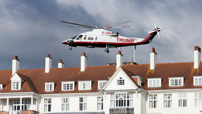 In this July 29, 2015 file photo, a helicopter owned by Donald Trump departs from the Turnberry golf course in Turnberry, Scotland.