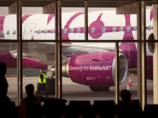 Travelers get ready to board WOW Airlines out of Keflavik