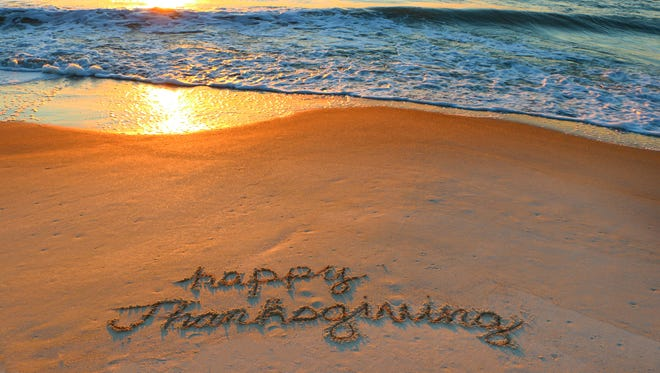 """Happy Thanksgiving"" written in the sand on Hilton Head Island during a beautiful sunrise."