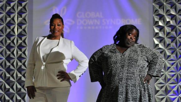 Queen Latifah strikes a pose with DeOndra Dixon, Jamie