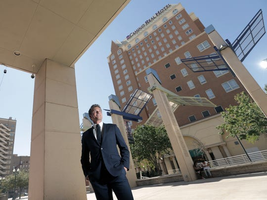 Josh Meyers, director of real estate development for the Meyers Group, stands across the street from the Camino Real Hotel, which the company plans to renovate in  Downtown El Paso.