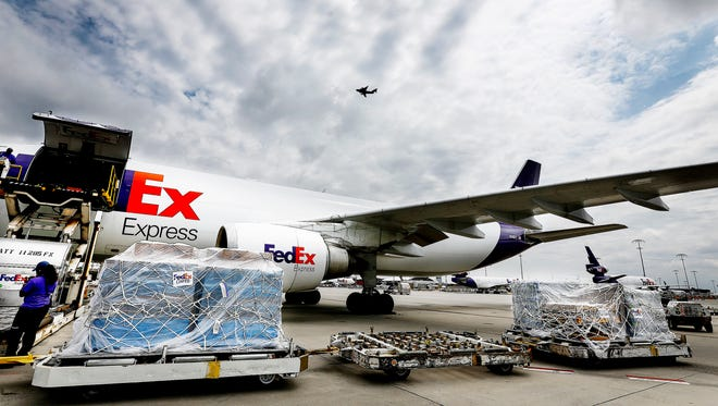 Under cloudy skies, a FedEx A300 Airbus is loaded with 20,000 meals ready to eat that were headed to Houston to aid relief efforts.