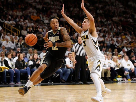 Purdue forward Vincent Edwards, left, drives past Iowa