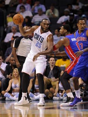 Charlotte Bobcats center Al Jefferson (25) prepares to pass the ball against the Detroit Pistons.