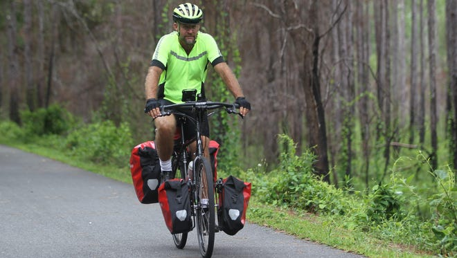 Kevin Record, veteran tennis coach at Leon High School for 15 years, is using this summer to follow up last year's 3,700-mile ride across the country with a cycling trip through some of the toughest parts of Alaska.