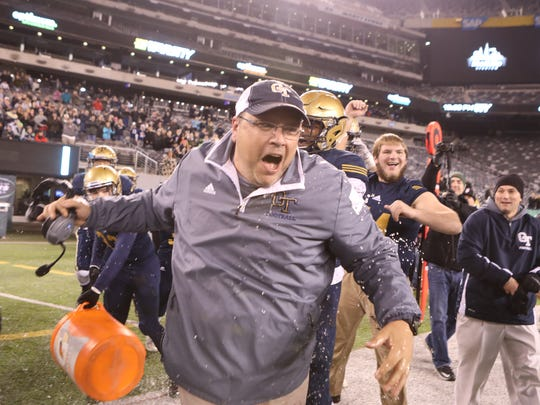 Old Tappan Assistant Coach, Pete Dunn is doused with water after the NJSIAA North I Group IV Football Championship in East Rutherford, Sunday, December 2, 2017.