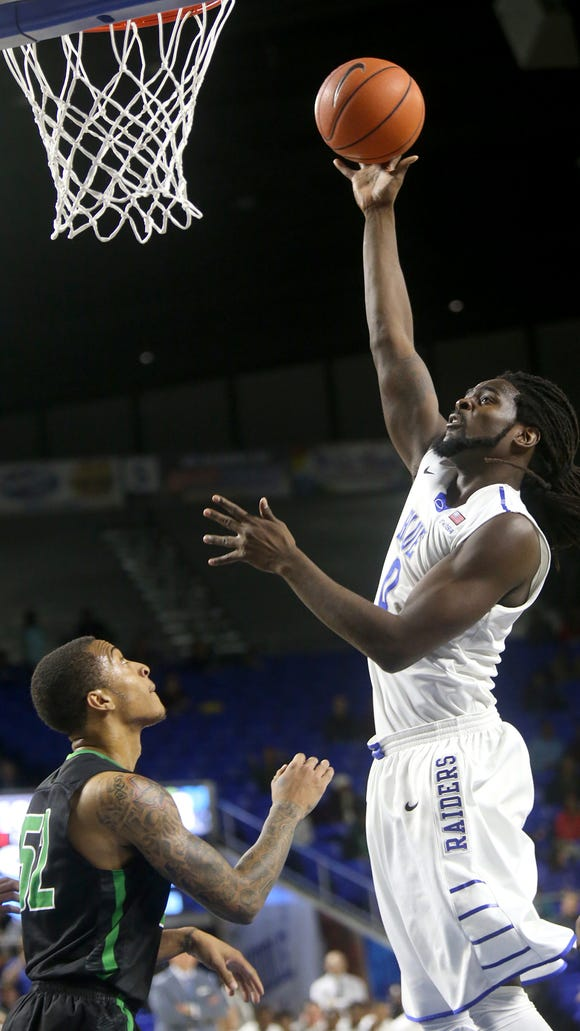 MTSU's Darnell Harris (0) hasn't been his typical self recently. Head coach Kermit Davis said the senior center had a great week of preparation ahead of the matchup with Michigan State.