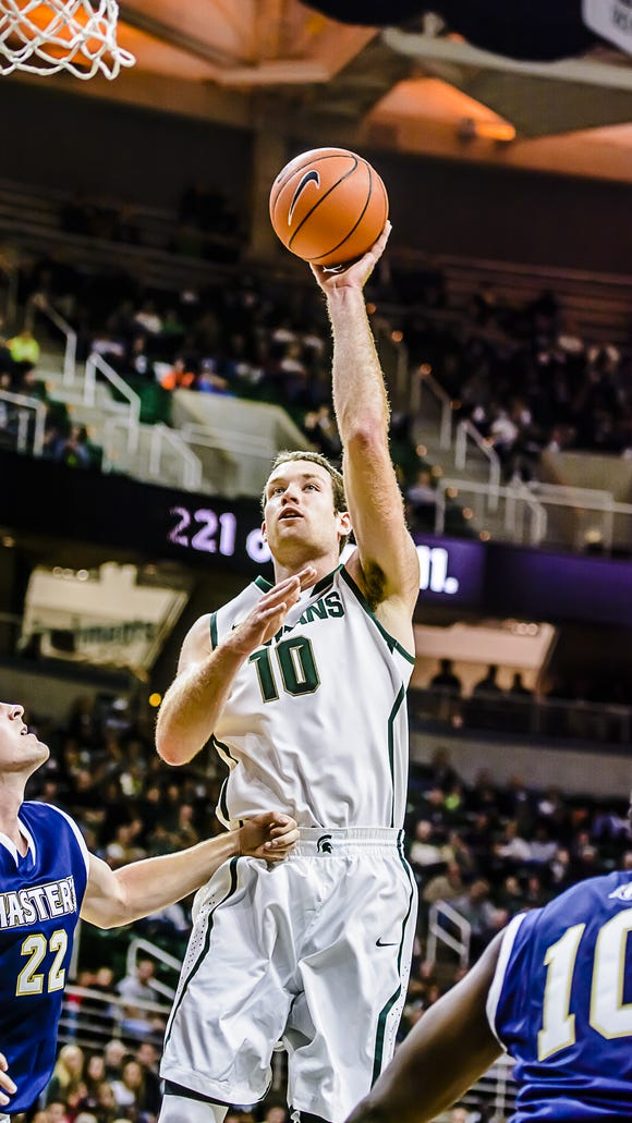 Matt Costello, middle, had six points and seven rebounds in 17 minutes of action Monday during MSU's exhibition victory over Chris Patureau (22) and The Master's College.