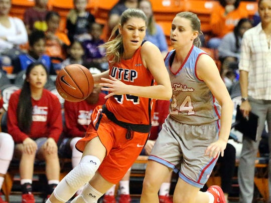Katarina Zec of UTEP drives downcourt against Taylor Stahly of Louisiana Tech.
