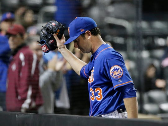 Mets starting pitcher Matt Harvey (33) gestures to fans as he leaves the game during the seventh inning of a game against the  Braves on Thursday, April 6, 2017, in New York. Harvey got the win in the Mets' 6-2 victory.