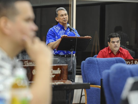 Sen. Tom Ada, author of Bill 175, replies to inquiries from fellow senators as to what percentage of available Chamorro Land Trust Commission land should be considered for commercial use during session at the Guam Legislature in Hagatna on Tuesday, Oct. 20.