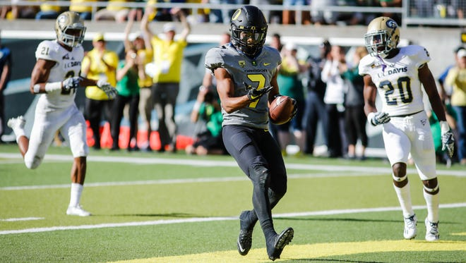 Oregon wide receiver Darren Carrington II (7) scores on a touchdown reception against UC Davis in an NCAA college football game in Eugene, Ore., Saturday, Sept. 3, 2016. Oregon on 53-28. (AP Photo/Thomas Boyd)