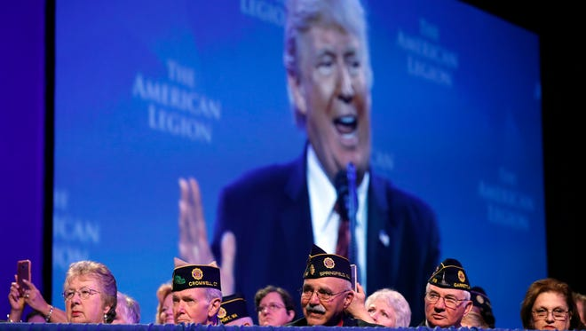Members listen as President Donald Trump speaks at the National Convention of the American Legion, Wednesday, Aug. 23, 2017, in Reno, Nev.