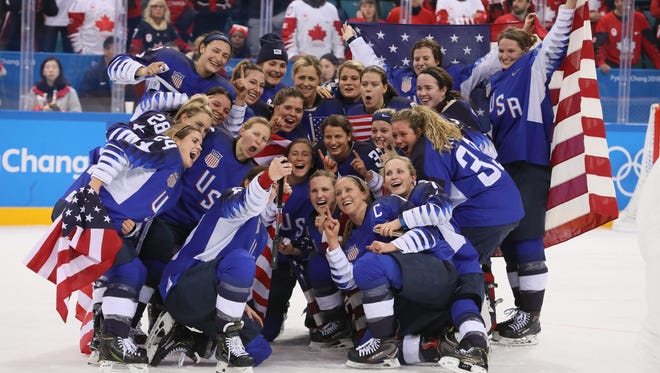U.S. players celebrate after defeating Canada in the women's ice hockey gold medal match Thursday.