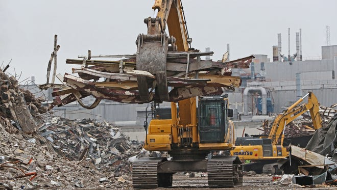 Scrap metal is moved to where it can be hauled away at the former General Motors plant in Janesville.