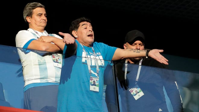 Argentina former soccer star Diego Maradona waves to the fans before Tuesday's match between Argentina and Nigeria.