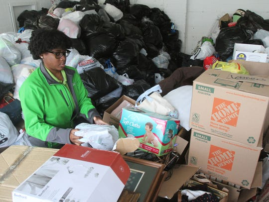 Traci Buchanan sorts out items dropped off to Green