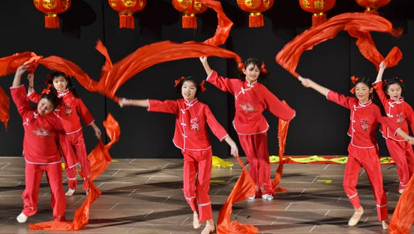 Members of The Chinese School perform during the Chinese