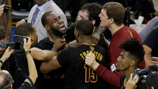 Cleveland Cavaliers forward LeBron James, top left, celebrates with teammates after Game 7 of basketball's NBA Finals against the Golden State Warriors in Oakland, Calif., Sunday, June 19, 2016. The Cavaliers won 93-89.