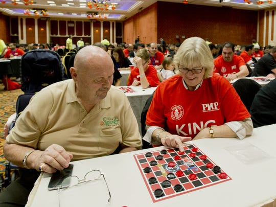 Sparks Mayor Geno Martini participates in a Guinness World Record-setting checkers event as part of the People Helping People Convention on February 8, 2014 at the Peppermill Resort and Casino Tuscany Ballroom in Reno, Nevada.