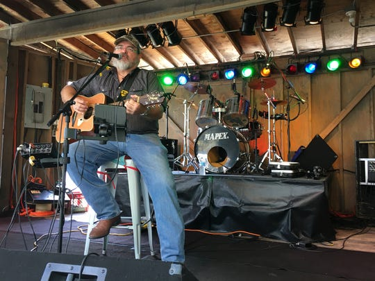 J.D. Owen performs on the Log Cabin Stage at the Sandusky County Fair on Wednesday.
