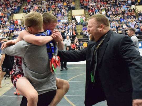 Riverheads' G.W. Shultz celebrates his 113-pound title with assistant coach Shalone Goff and head coach Scott Swats at the VHSL Group 1A state wrestling championships on Saturday, Feb. 18, 2017, at the Salem Civic Center in Salem, Va.