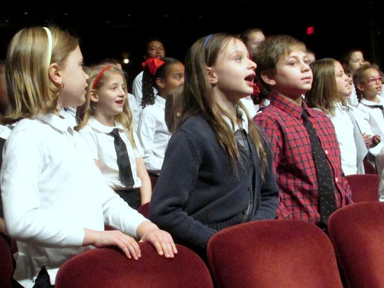 The Arctic League Kids Choir sings Christmas songs during Sunday's annual broadcast.