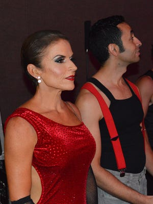 Nina Beck and partner Amine Raif wait to be introduced Friday before their dance.