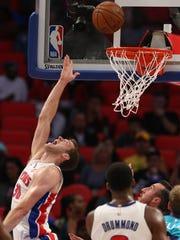 Pistons' Jon Leuer scores against the Charlotte Hornets